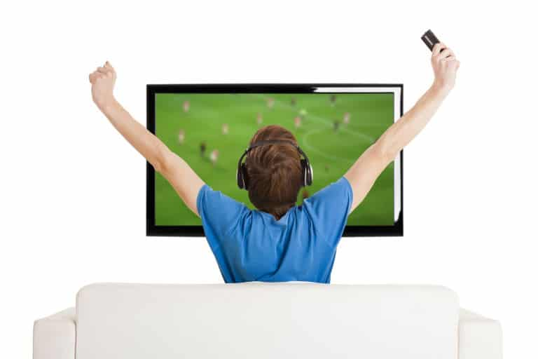 Guy watching TV with wi-fi headphones