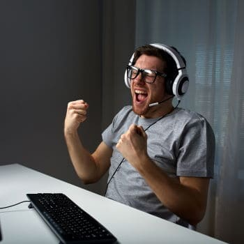Man playing video games with gaming headset