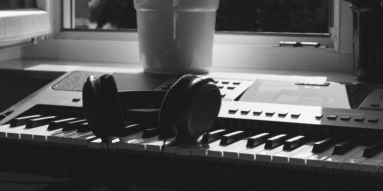 Open-back headphones on a piano