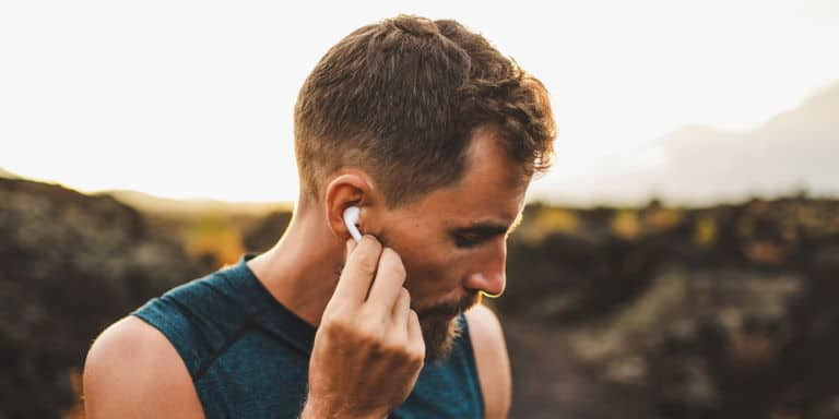 Man with wireless earbuds outdoor
