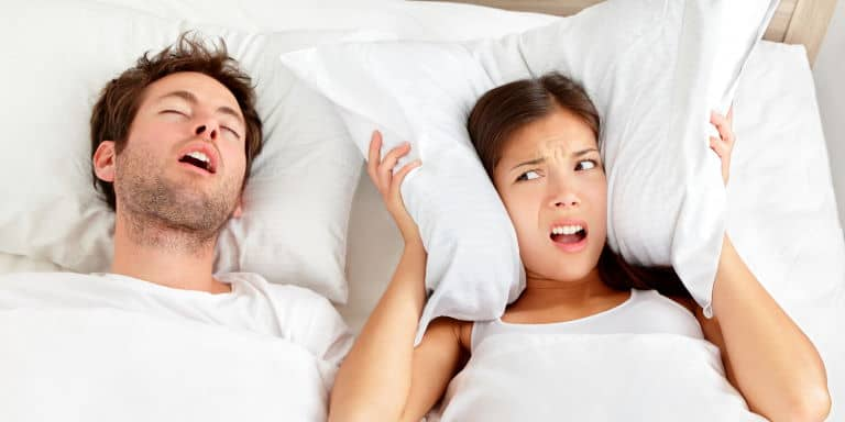Couple in bed - Snoring man
