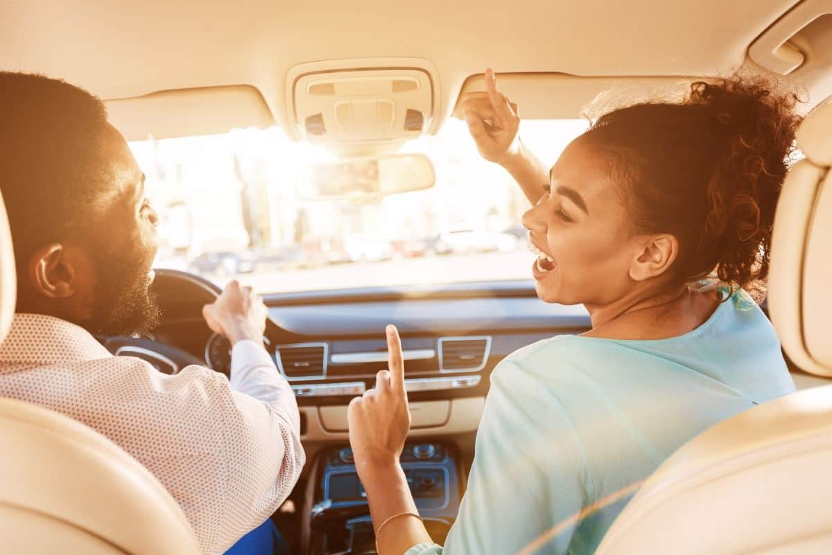 A couple listening to music in the car