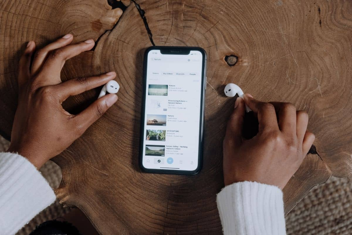AirPods by a smartphone